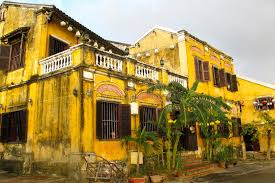 french colonial style yellow french colonial style house in hoi an vie stock photo
