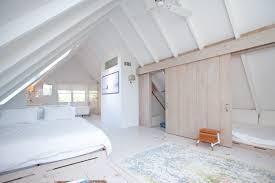 bridgehampton home where master bed and bath share a room asks