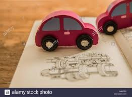 wooden car wooden car open book with scheme of cogwheel environmentally
