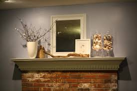 foxy image of home interior decoration using twig branch fireplace