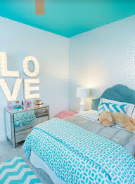 Turquoise Blue Girls Bedroom Features A White Feather Chandelier - Girl bedroom colors