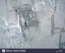 Textured Paint For Exterior Concrete Walls - graffiti and old paint on exterior wall forms an abstract urban