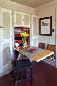 saving small dining room spaces with fold down dining table