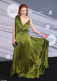eleanor tomlinson looks striking in a satin green gown at british