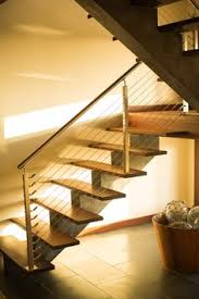 extensive modern staircase with cable railing by stainless cable