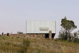 green prefab in uruguay redefines boundaries with minimalist approach