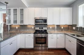 gray countertops with white cabinets white kitchen with dark tile floors small white galley kitchen ideas