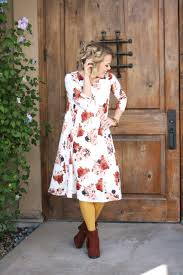 how to wear a swing dress floral swing dress tights ankle