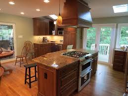 kitchen design wooden kitchen island with modern stove top on