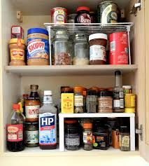 how to store food in cupboards kitchen storage solutions cupboard organizer raised