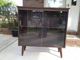 mid century style bookcase cabinet with sliding glass doors by