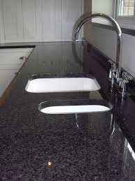 blackpearl granite contrasts elegantly with the white ceramic