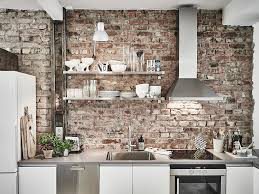 scandinavian interior apartment with mix of gray tones brick
