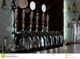 Stainless Steel Beer Faucet Row Of Beer Taps On A Stainless Steel Keg In A Pub Royalty Free
