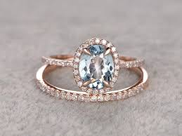 halo wedding rings images 2 carat oval cut aquamarine and diamond halo wedding ring set in jpg