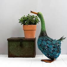 metal garden ornaments hen goose flamingo or peacock by the