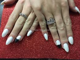 social build acrylic nails with white gel polish and black