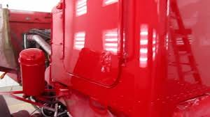 paint job on peterbilt 357 tandem axle chassis vermillion red