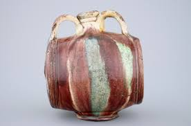 Vase Shaped Jug A Polychrome Glazed Pottery Barrel Shaped Jug Saintonge France