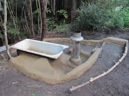image result for outdoor cast iron bath cob rocket stoves