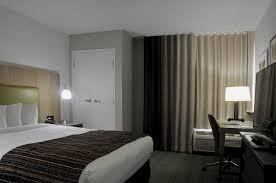 hotel bedroom lighting upgrade to led light bulbs to reduce energy costs improve lighting