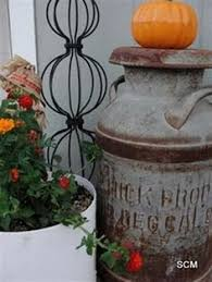 Old Milk Can Decorating Ideas Old Iron Wheel Rake And Watering Can With A Dried Arrangement In