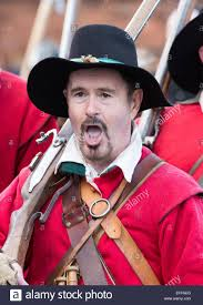 people dressed up as roundheads and cavaliers re enacting the