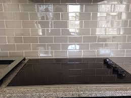 cutting tile backsplash how to paint particle board cabinets stone