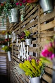 Pallet Wedding Decor For A Low Budget Construction Challenged Wedding Backdrop I E