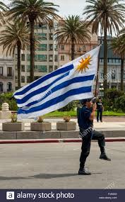 Flag Uruguay Police Officer Marching With Flag At The Parade In Montevideo