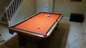 used pool table assembly with denver broncos pool table cloth in