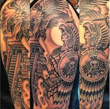 black ink aztec warrior with flying eagle tattoo on half sleeve