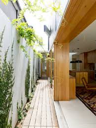 building a small home plein air passageway maximise the green space in a small home by