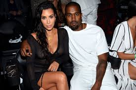 kim kardashian and kanye west hired a surrogate to carry third