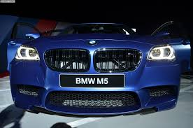 bmw headlights at night bmw m5 facelift with 575 hp makes debut at 2013 m festival