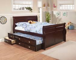 Bedroom Laminate Flooring Ideas Dark Brown Wooden Trundle Bed Frame Having White Bed And Blue