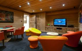 wooden ceiling home theater with colorful seating as decor idea