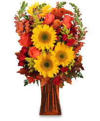 beautiful yellow sunflowers and and yellow roses make this
