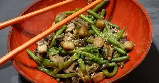 cuisiner au wok wok de fruits de mer aux légumes sautés recette par gourmicom