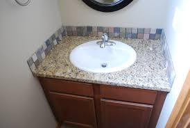 bathroom backsplash ideas gold countertop brown marble mosaic