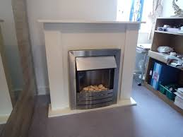 adam sutton ivory electric fire place suite in llandudno conwy