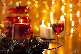 christmas decorations and candles set on a dining table stock