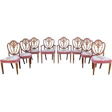 set of eight carved mahogany shield back dining chairs with from
