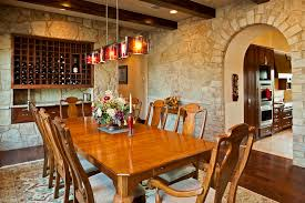 kitchen table with built in wine rack wine rack wall dining room mediterranean with area rug wood dining table
