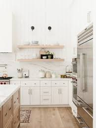 wood tone kitchen cabinets two tone cabinets are the commitment phobe s answer to