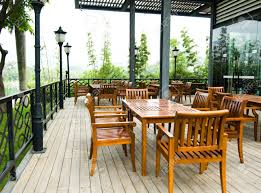 Wooden Patio Chair by House Patio With Wooden Patio Furniture Stock Photo Picture And