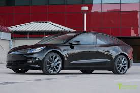 black tesla model 3 with 19 inch metallic gray tst wheels tesla