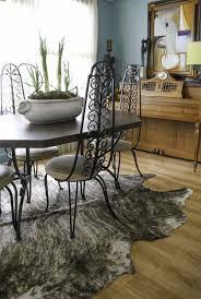 jan 2014 cowhide rug idea 27 u2026 iron chairs black and white