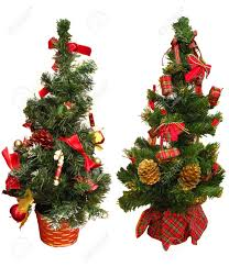 two little christmas trees as a decoration ornaments isolated