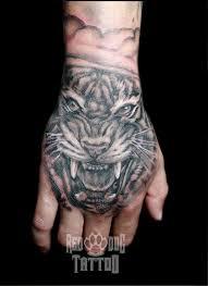 hand tattoo etiquette tiger hand tattoo by reddogtattoo on deviantart